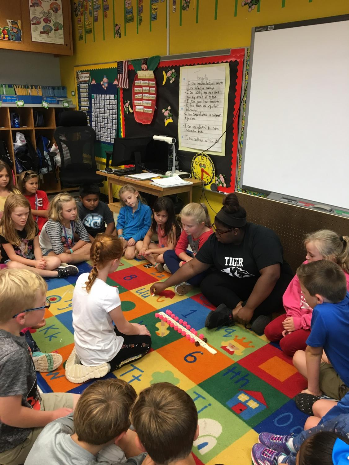 Shyon Williams participates in the principles of teaching co-op program.  During her placement at Western Elementary where she assists second grade students with lessons.