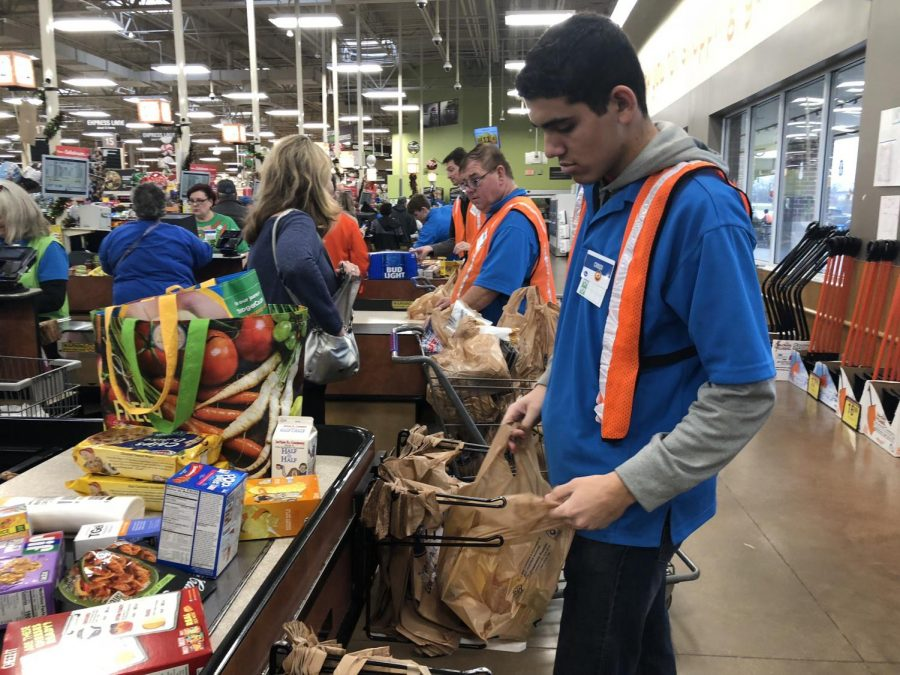 Creed+Carnes%2C+senior%2C+enjoys+his+work+as+a+bagger+at+Kroger.++This+local+grocery+employs+several+SCHS+students.++