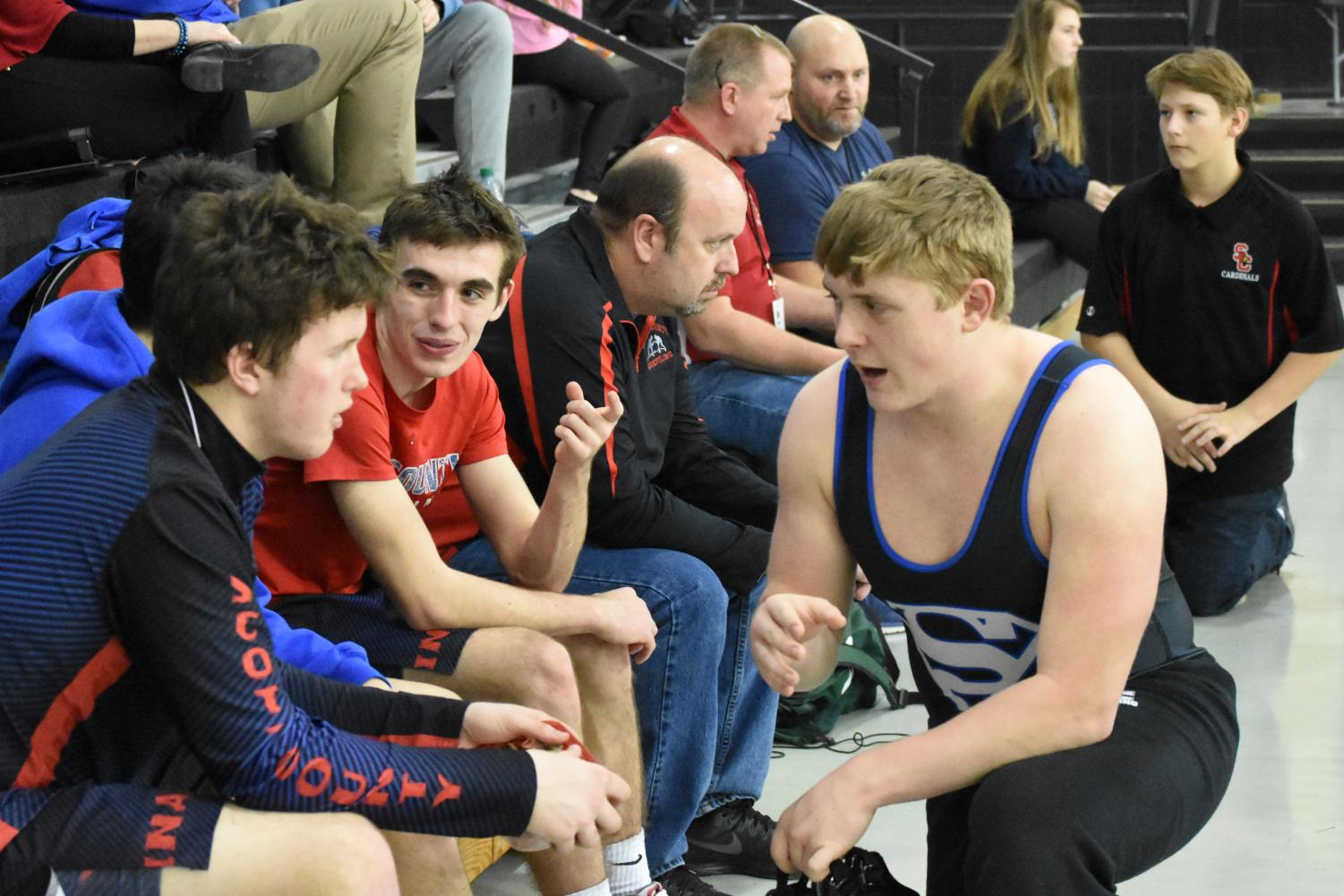 Juniors+John+Hulette+and+Truman+Galusha+talk+with+a+fellow+wrestler+from+South+Oldham+High+School.++The+wrestling+community+is+a+tight+knit+community+that+emphasizes+respect+and+good+sportsmanship.+