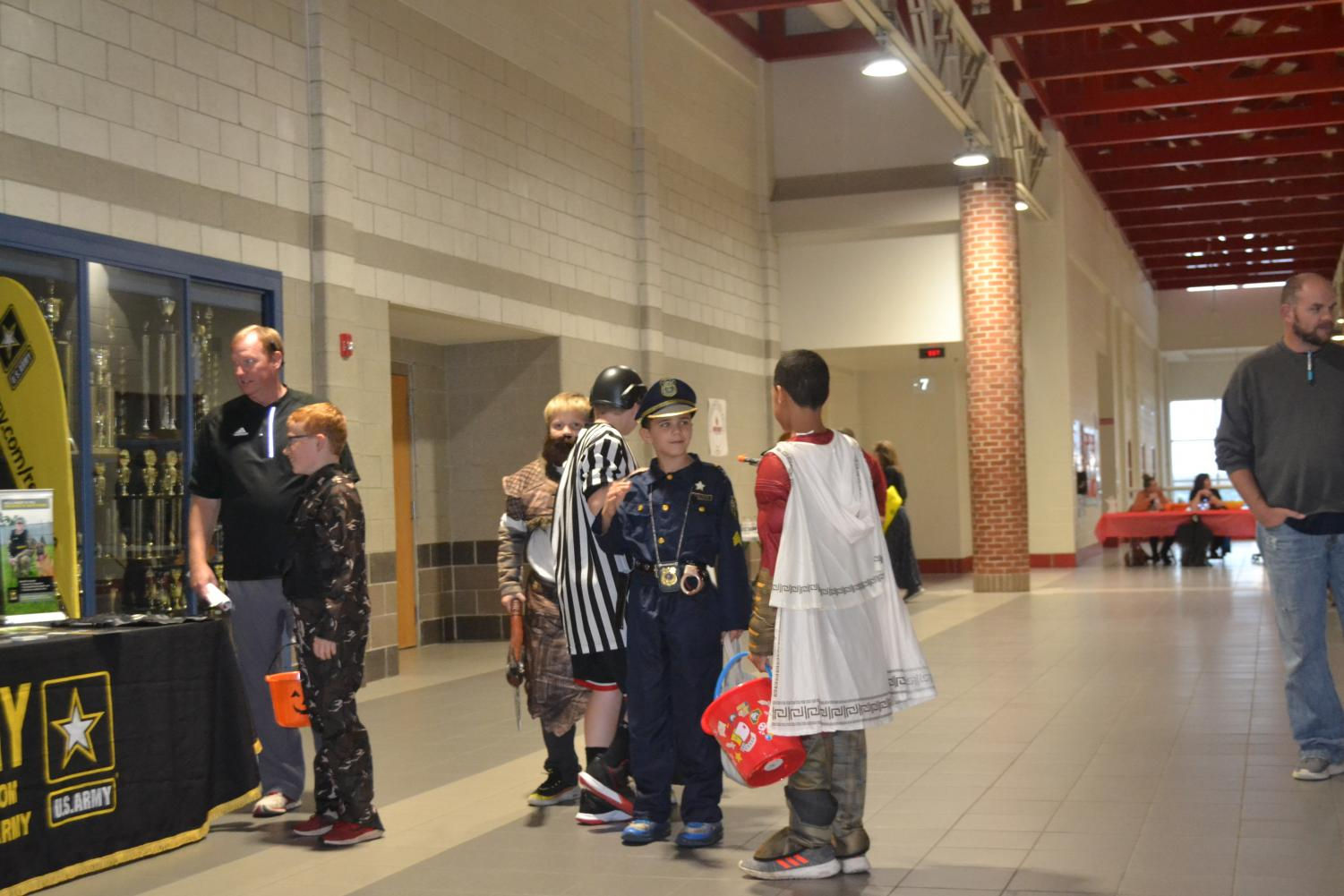 Children from the community dress up to trick-or-treat throughout the building at Scott County High School.