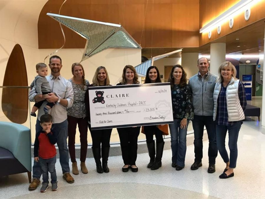 Jill and Brandon Embrey donate the proceeds of Ride For Claire to the Kentucky Children's Hospital.