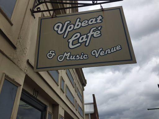 One coffee shop's sign, Upbeat Cafe, hangs prominently in downtown Georgetown.
